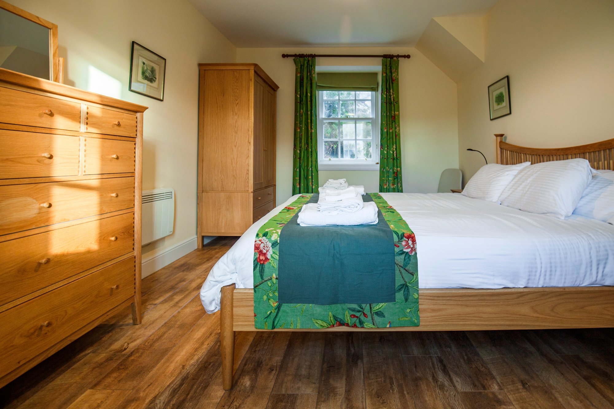 Amhuinnsuidhe holiday cottages. Castle Cottage for up to six people with views across Loch Leosavay to South Harris. King bedroom 1.
