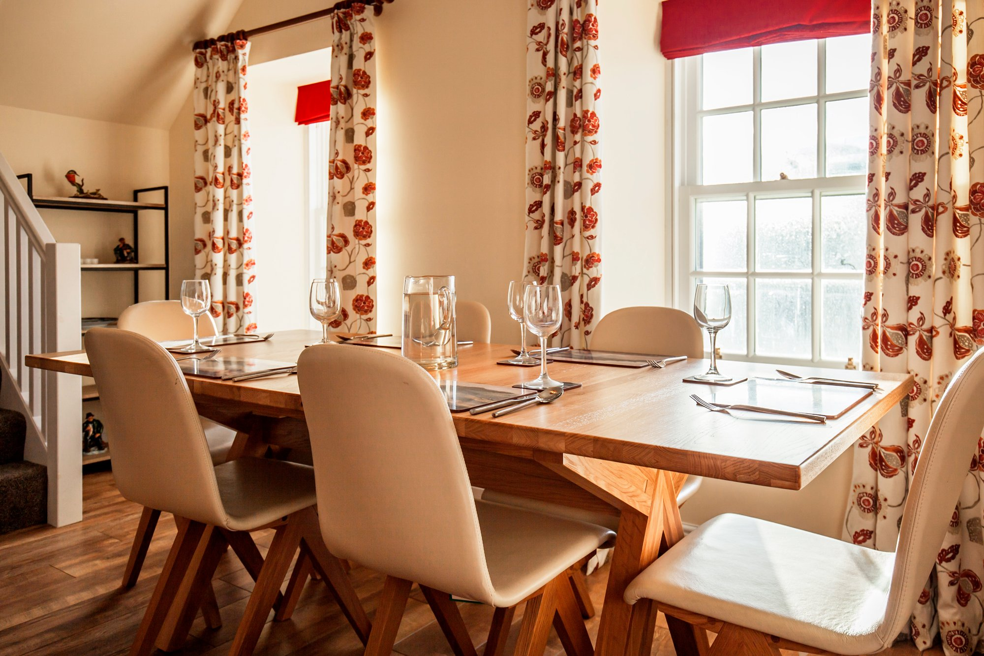 Amhuinnsuidhe holiday cottages. Castle Cottage for up to six people with views across Loch Leosavay to South Harris. Dining area.