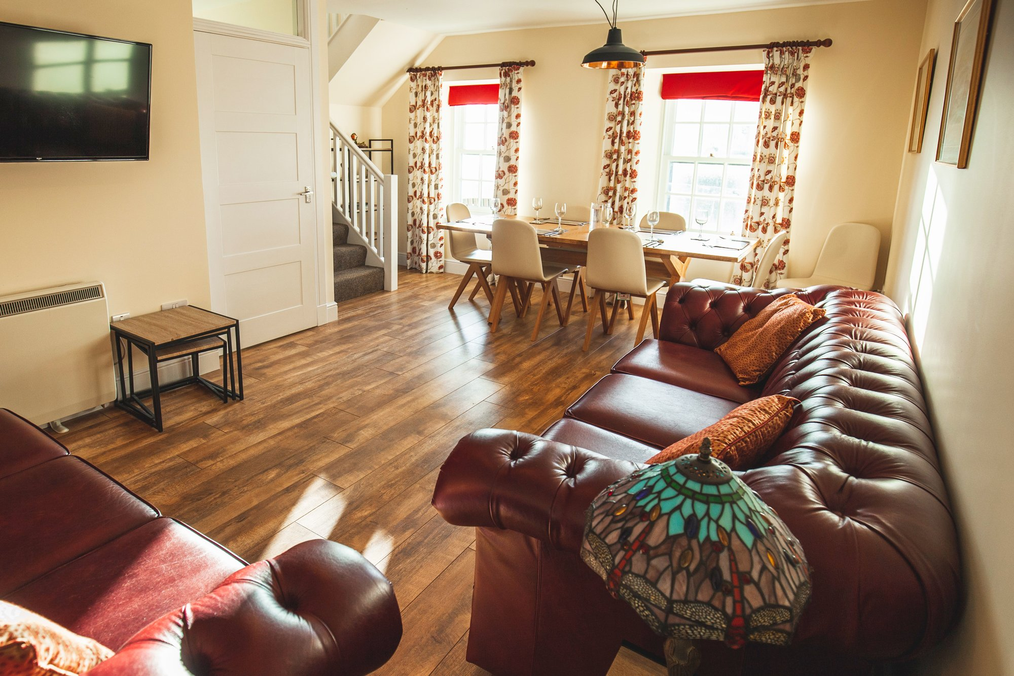 Amhuinnsuidhe holiday cottages. Castle Cottage for up to six people with views across Loch Leosavay to South Harris. Open plan living dining area.