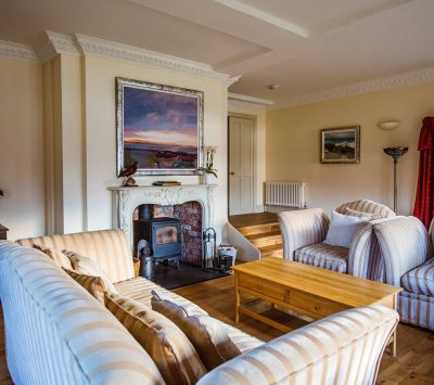 Morsgail Lodge, Isle of Lewis holiday accommodation comfortable enjoy the drawing room with cosy wood-burning stove